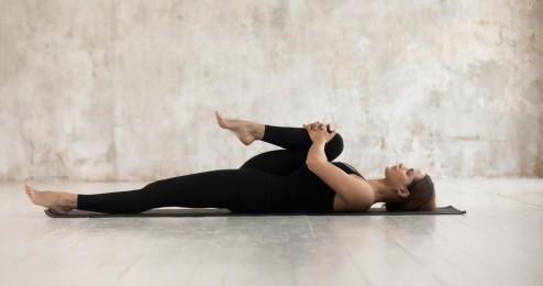Woman,Wear,Black,Sport,Clothes,Lying,On,Floor,Practising,Asana