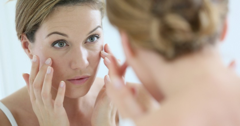 Middle-aged,Woman,Applying,Anti-aging,Cream