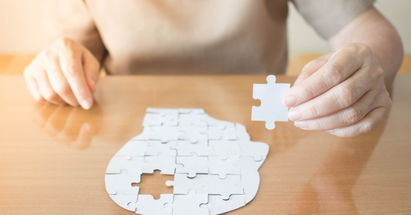 Elderly,Woman,Hands,Holding,Missing,White,Jigsaw,Puzzle,Piece,Down