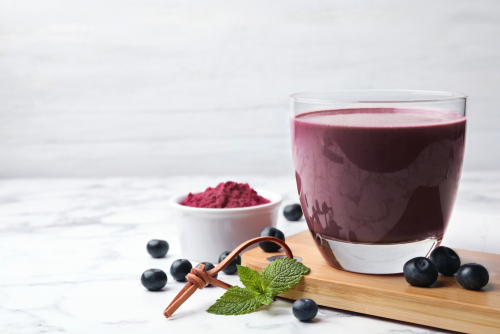 Tasty,Acai,Drink,,Powder,And,Berries,On,Marble,Table.,Space