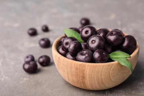 Bowl,Of,Fresh,Acai,Berries,On,Grey,Stone,Table,,Closeup