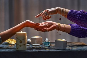 Magic,Gypsy,Woman,Reading,Palm,Lines,Around,Candles,And,Other