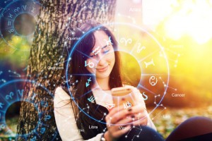 Astrology,Smartphone,App,Concept.,Woman,Using,Mobile,Phone