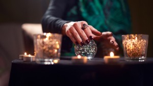 Close-up,Of,Fortuneteller,Female,Divining,On,Magic,Ball,At,Table