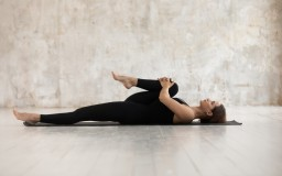 Woman,Wear,Black,Sport,Clothes,Lying,On,Floor,Practising,Asana
