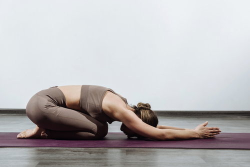 Young,Woman,Doing,Yoga,Indoors,On,The,Mat,Doing,Relaxation